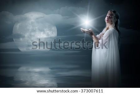 Elven girl with star on sea coast - stock photo