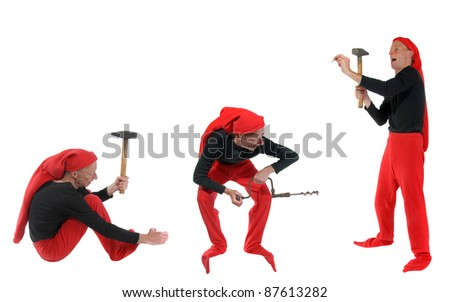 Elves working with different tools, such as a hammer and a drill - stock photo