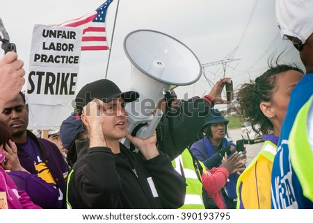 ELWOOD, ILLINOIS - OCTOBER 1, 2012: Striking workers and supporters from the Walmart distribution center march for better wages and working conditions. - stock photo