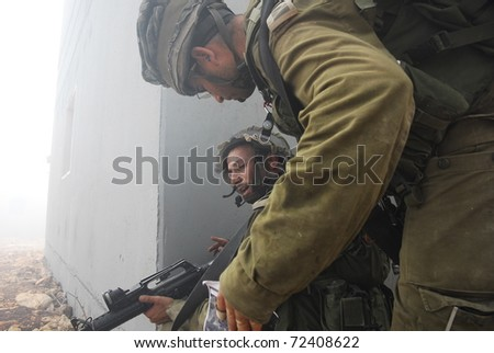 ELYAKIM, ISRAEL - MARCH 01: Israeli infantry train in urban combat fighting. March 01, 2011 in Elyakim, Israel - stock photo
