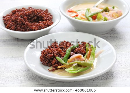 ema datshi (traditional chili cheese stew) with red rice,bhutanese cuisine