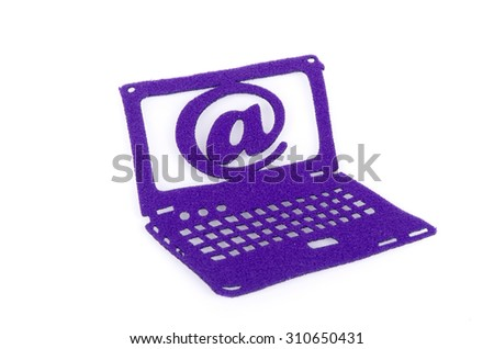 Email and laptop symbol made from carpet fabric over white background