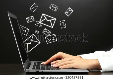 Email concept with laptop and hands - stock photo