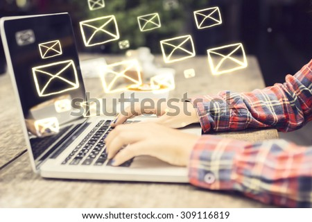 Email concept with laptop ang girl hands - stock photo