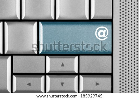 Email key on a computer keyboard with clipping path around the Email key - stock photo