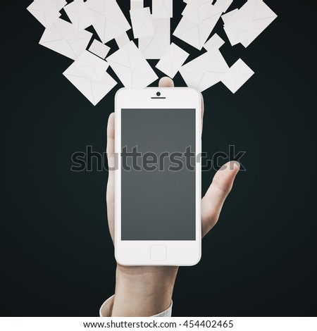 Email marketing concept with hand holding blank smartphone with abstract letters on dark background. Mock up, 3D Rendering - stock photo