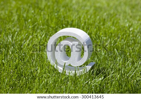 Email sign on green grass  - stock photo
