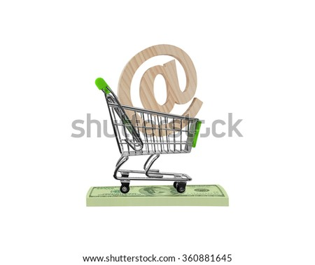 Email symbol (commercial at symbol) made of wood in green shopping cart on stack of money one hundred dollars bills isolated on white background - stock photo