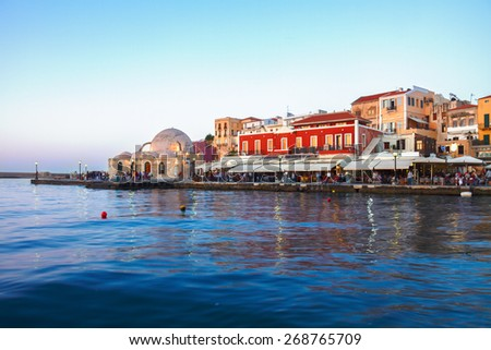 embankment and venetian habour with  Turkish Mosque Yiali Tzami of Chania at sunset, Crete, Greece - stock photo