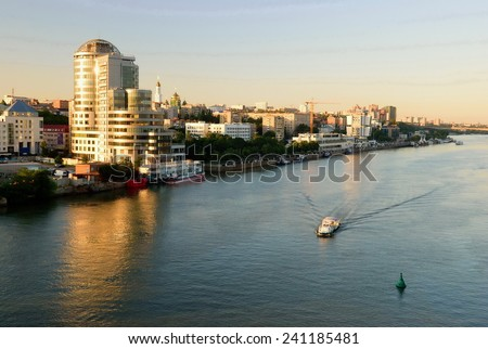 "Embankment at dusk. View of the hotel ""fifth ocean"". Rostov-on-Don. Russia - stock photo"