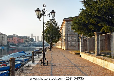 Embankment in the old central part of Peschiera del Garda, Italy - stock photo