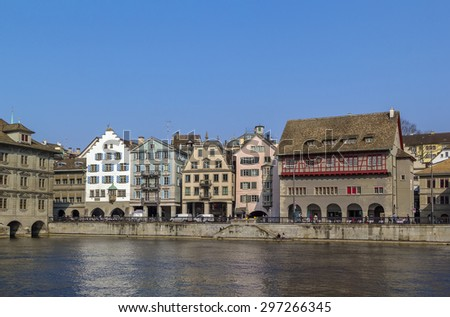 embankment of Limmat river with historic houses in Zurich center, Switzerland - stock photo