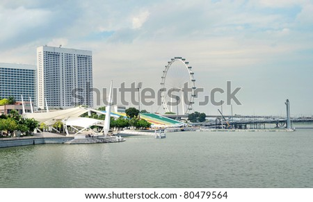 Embankment of Singapore and Singapore Flyer in the sunshine day - stock photo