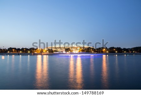 Embankment of the Moskva River and Luzhniki Stadium, night view, Moscow, Russia. - stock photo
