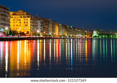 Embankment of Thessaloniki with reflection in the sea at twilight. Greece