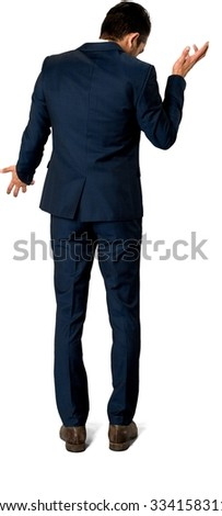 Embarrassed Caucasian man with short dark brown hair in business formal outfit talking with hands - Isolated
