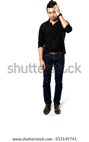 Embarrassed Caucasian man with short dark brown hair in casual outfit with hands on head - Isolated