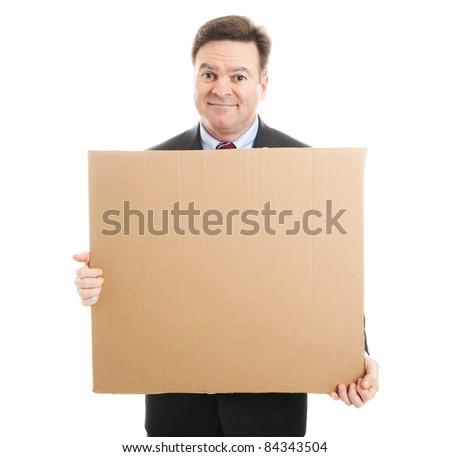 Embarrassed jobless businessman holding up a blank cardboard sign.  Isolated on white. - stock photo
