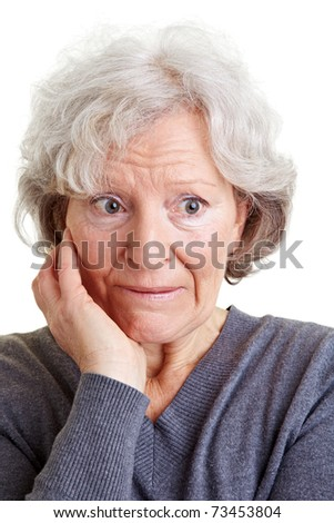 Embarrassed old senior woman looking shy to the side - stock photo
