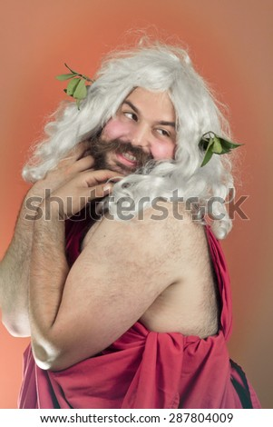 Embarrassed zeus god or jupiter looks over his shoulder and blushes - stock photo