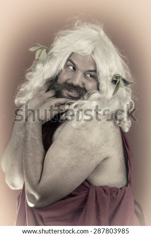 Embarrassed zeus looks over his shoulder and blushes - stock photo