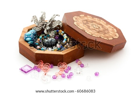 Embellishments and hexagonal half opened box on white background