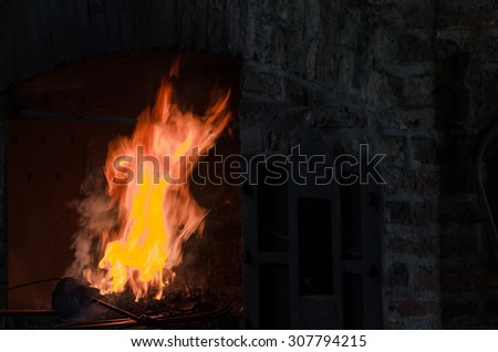 Embers and flame from a forge - stock photo