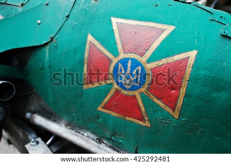 Emblem at military car of the Armed Forces of Ukraine - stock photo