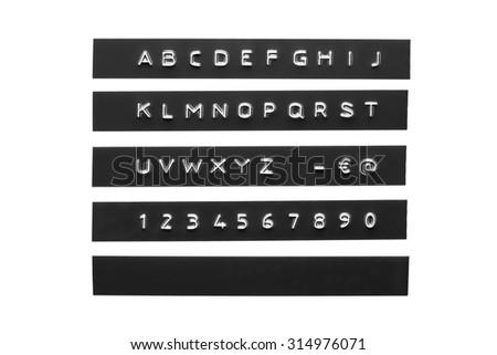 Embossed alphabet on black plastic tape - stock photo