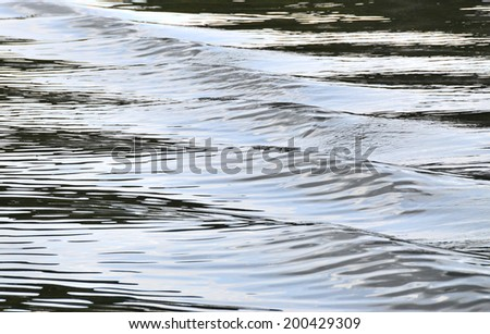 Embossed contrast waves: gleams, reflexes and half-shades on the lake surface. Waves: relief on the water surface, a series of images - stock photo