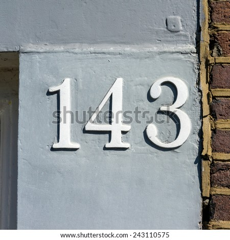 embossed house number one hundred and forty three - stock photo