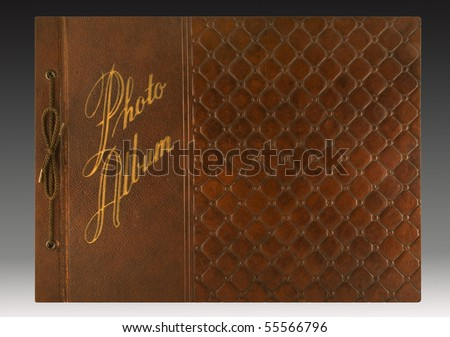 Embossed leather cover of a 1940s-era photo album with gold imprinting. includes clipping path. - stock photo