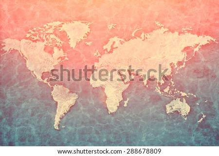 Embossed metal relief of the world map - stock photo