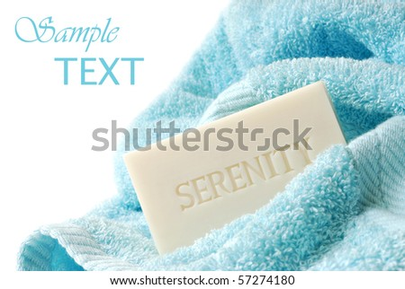Embossed soap with bath towel on white background with copy space.  Macro with shallow dof. - stock photo
