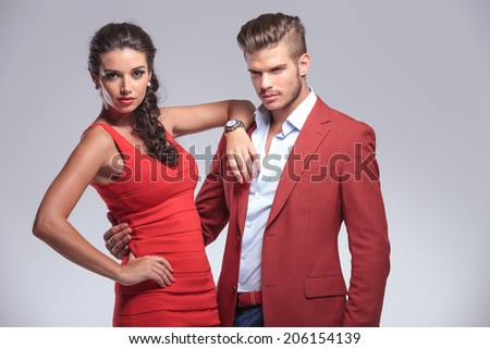 embraced fashion couple , man looking away from the camera
