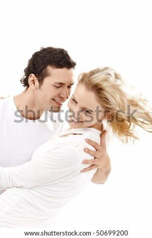Embracing enamoured couple on a white background - stock photo