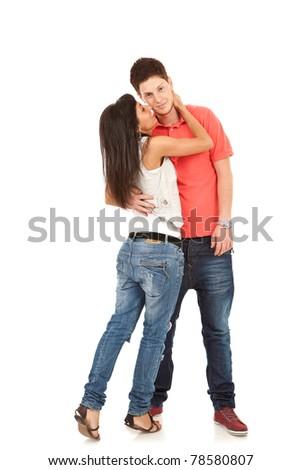 Embracing glamorous couple standing on white background - stock photo