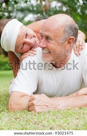embracing senior  love - stock photo