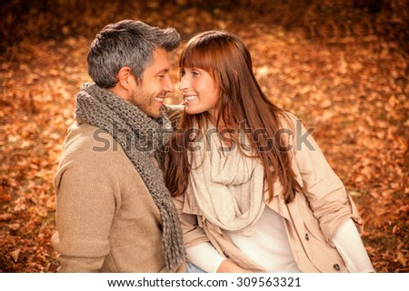 embracing sitting brown leaves - stock photo
