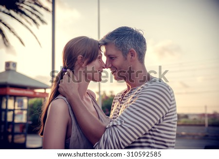embracing sweet kissing couple - stock photo