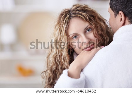 Embracing the happy couple close up - stock photo