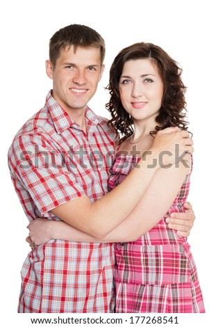 Embracing young man and woman isolated on white.  - stock photo