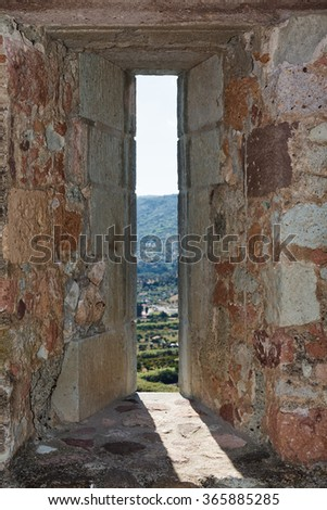 embrasure in the wall of fortress Bosa town in Sardinia - stock photo