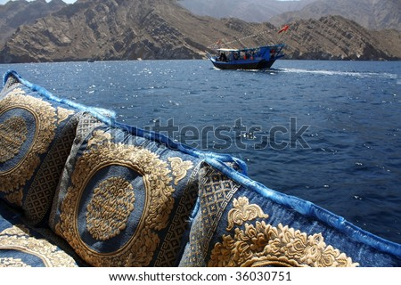 embroidered cushions and cruise in oman waters - stock photo