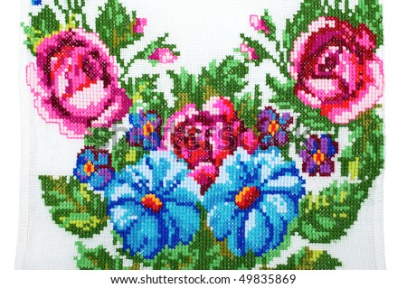 embroidered handmade good by cross-stitch pattern. like flower - stock photo