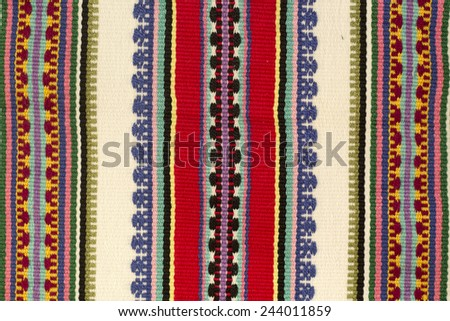 embroidered handmade good with ethnic pattern - stock photo