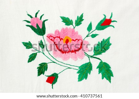 embroidered pink and red flowers - stock photo