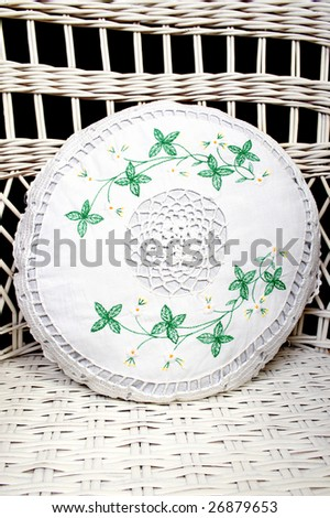 Embroidery on the round pillow - stock photo