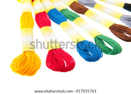 embroidery thread in colors isolated over white background - stock photo