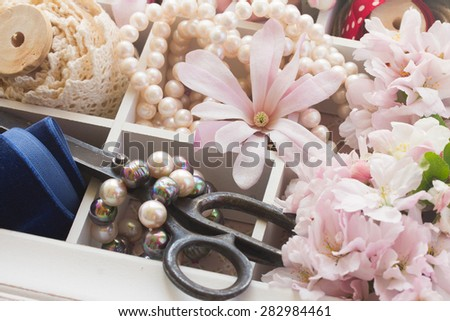 embroidery vintage  accessories with fresh flowers and pearls - stock photo